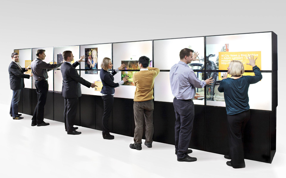 people using a multi-touch screen