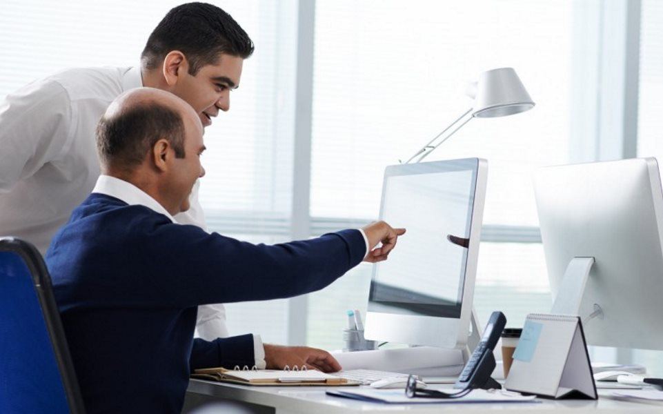 two software developers looking at a screen