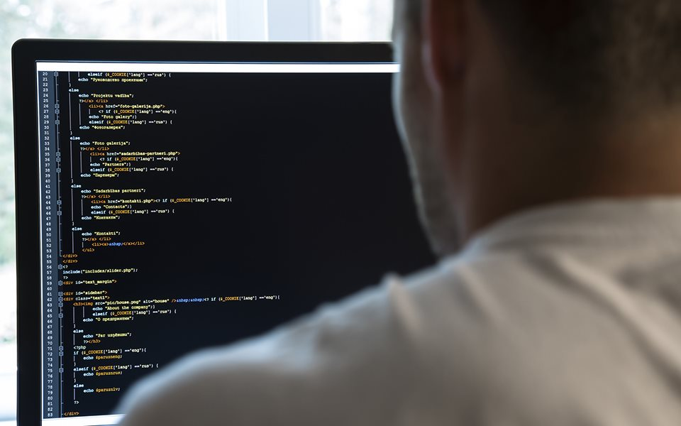 software developer looking at some code