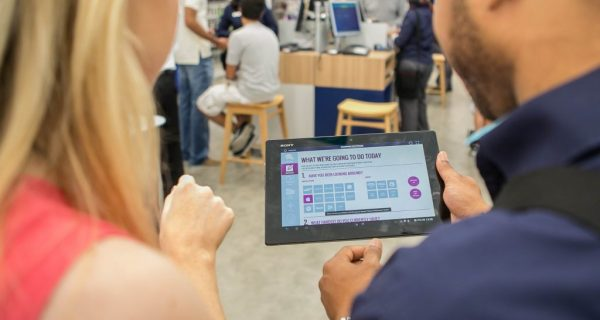 tablet based assisted selling app being used in store