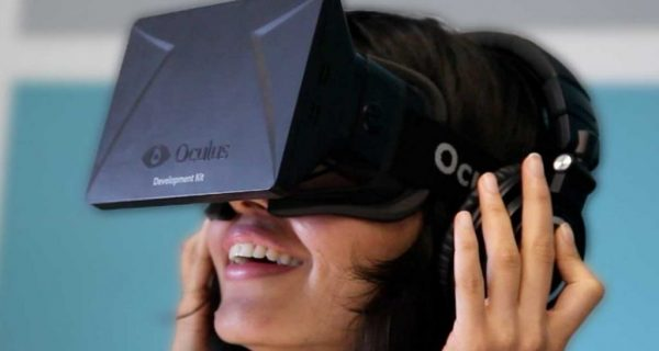 smiling woman using oculus rift virtual reality headset
