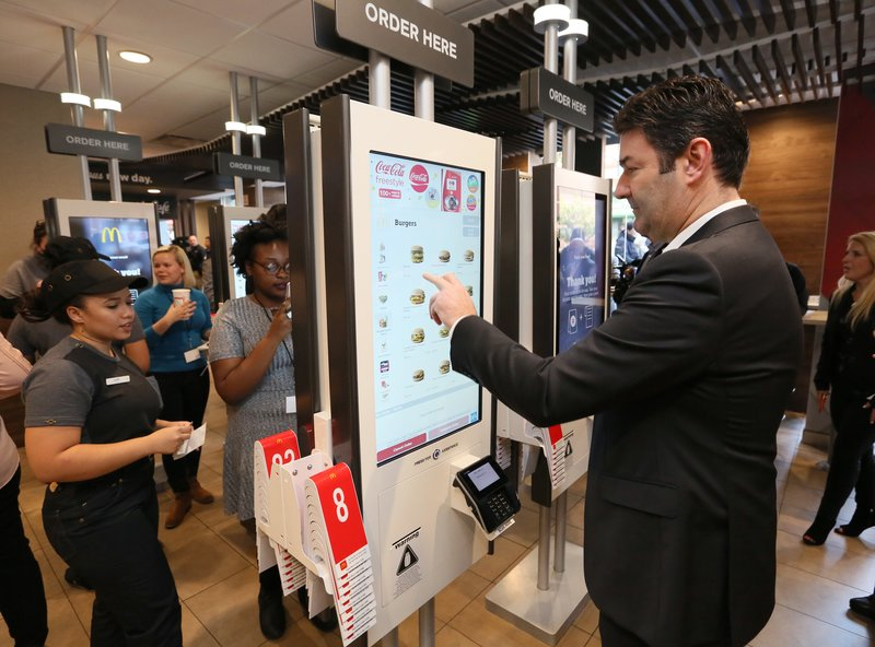 McDonald's Corporation Chief Executive Officer, Steve Easterbrook , demonstrates the ease of placing an order at the self-order kiosk, on Thursday, November 17, 2016, at a McDonald's restaurant in New York, N.Y. (Stuart Ramson/AP Images for McDonald's)